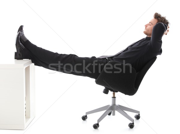 Businessman resting in office with legs on desk Stock photo © nyul