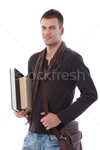 Főiskolai hallgató könyvek fiatal főiskola tart mosolyog Stock fotó © nyul