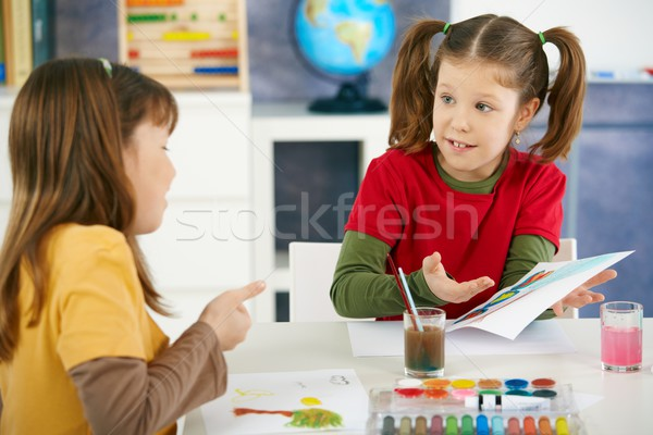 Stock photo: Children painting in art class at elementary school