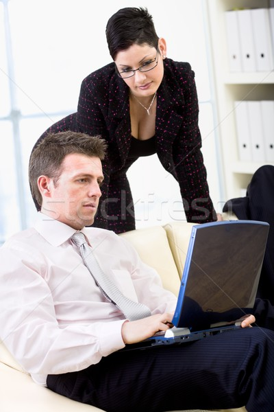 Businesspeople teamworking on laptop Stock photo © nyul