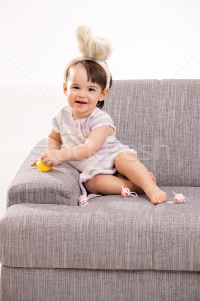 Stock photo: Baby girl with toy chicken and eggs