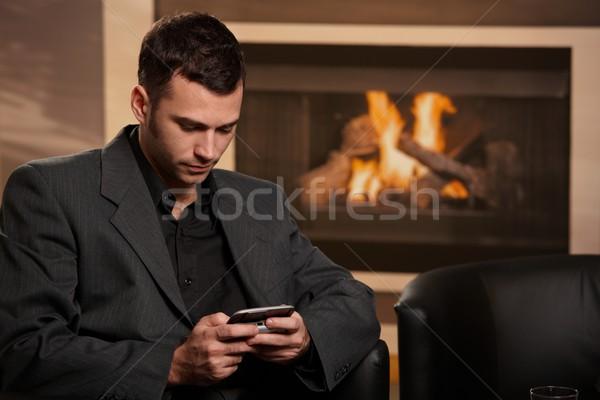 ストックフォト: ビジネスマン · 書く · 座って · リビングルーム · ホーム