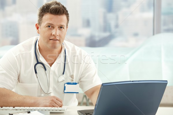 Mid-adult doctor in office Stock photo © nyul