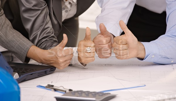 Closeup of 4 thumbs up in office Stock photo © nyul
