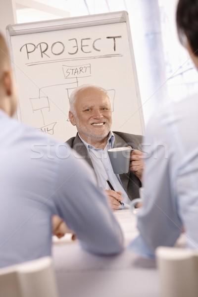 Senior businessman at team meeting Stock photo © nyul