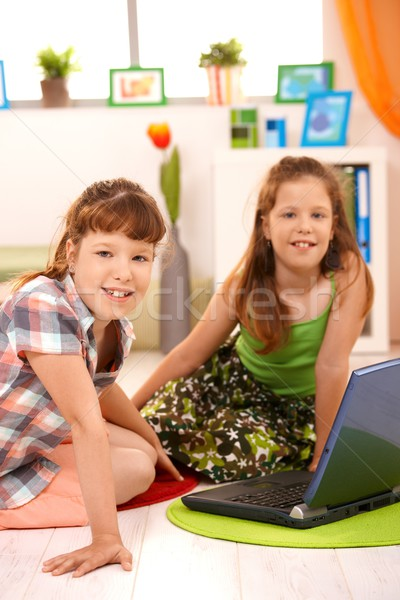 Small girls with computer at home Stock photo © nyul