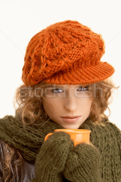 Pretty young woman dressed up warm drinking tea Stock photo © nyul