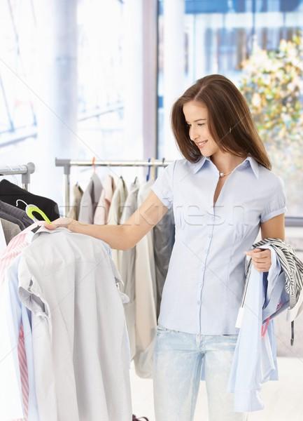 Pretty woman purchasing clothes Stock photo © nyul