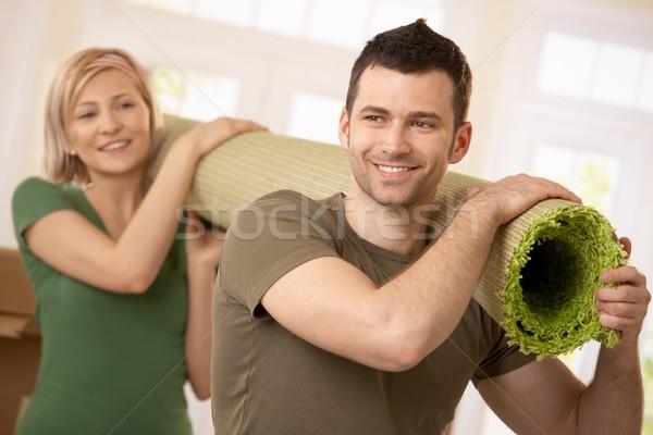 Stok fotoğraf: Mutlu · çift · halı · birlikte
