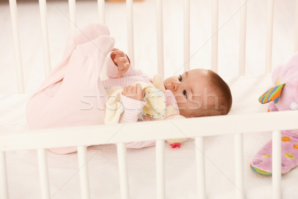 Cute baby playing with feet Stock photo © nyul