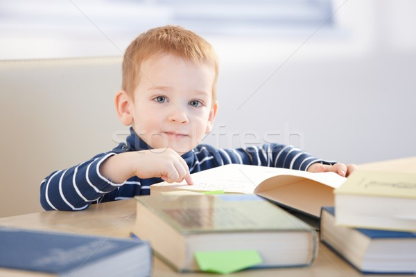 Eszes kicsi fiú tanul ül asztal Stock fotó © nyul