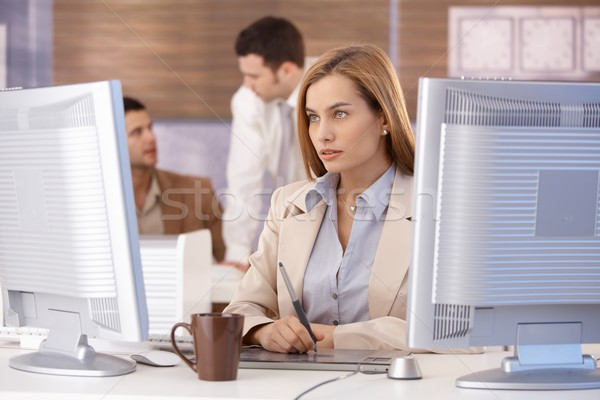 Attractive woman at computer training course Stock photo © nyul