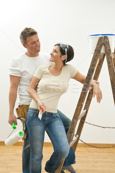 Happy couple painting first home Stock photo © nyul