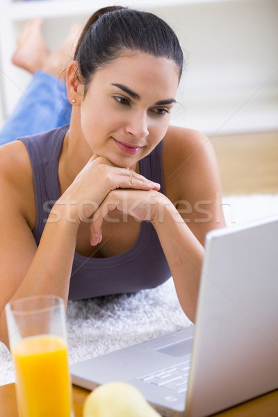Woman working on laptop at home Stock photo © nyul