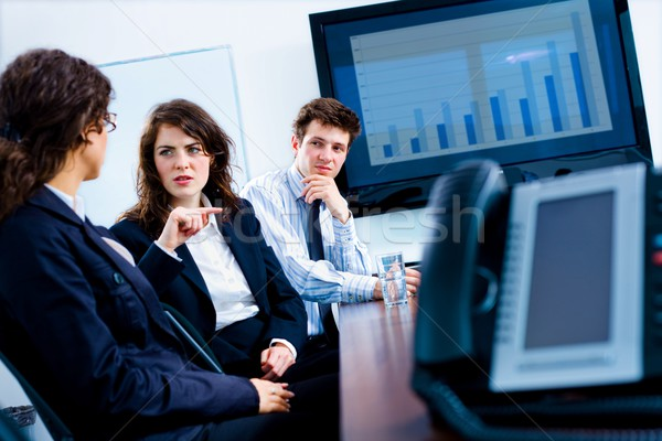 üzlet kommunikáció fiatal komoly üzletemberek beszél Stock fotó © nyul