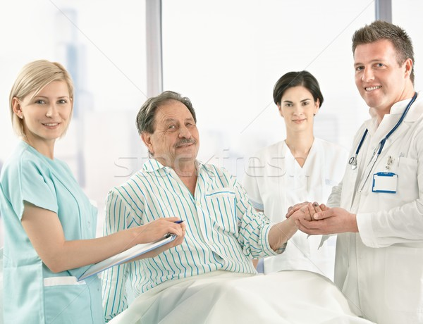 Medical team taking care of patient Stock photo © nyul