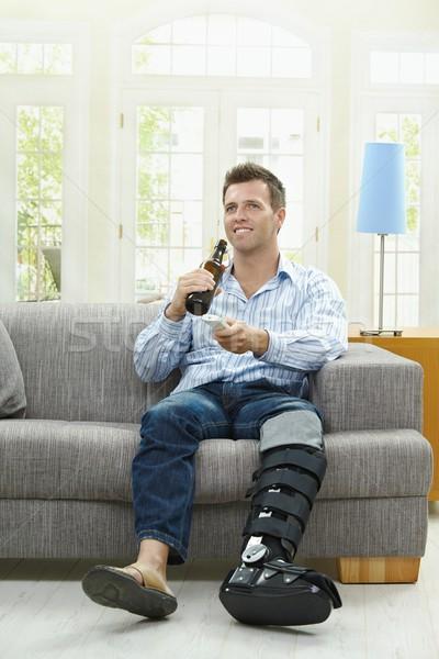 телевизор пива человека смотрят домой сидят Сток-фото © nyul