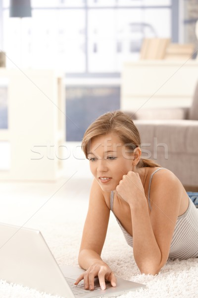 Stock photo: Casual woman using laptop computer