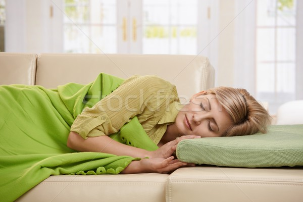 Blond woman sleeping on couch Stock photo © nyul