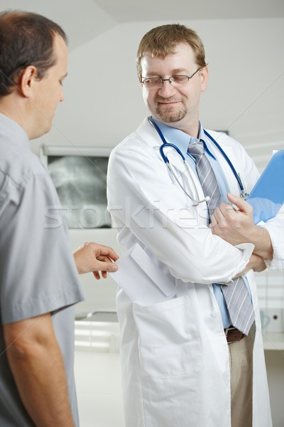Patient bribing doctor Stock photo © nyul