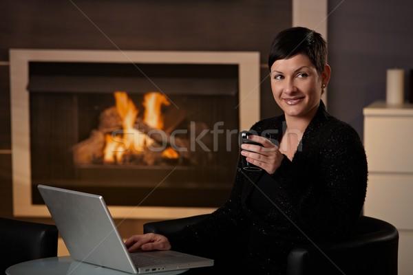 Kadın ev genç kadın oturma şömine Stok fotoğraf © nyul
