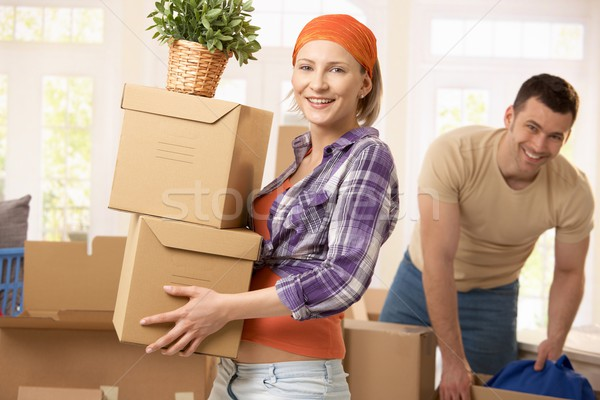 Stock photo: Happy couple moving house