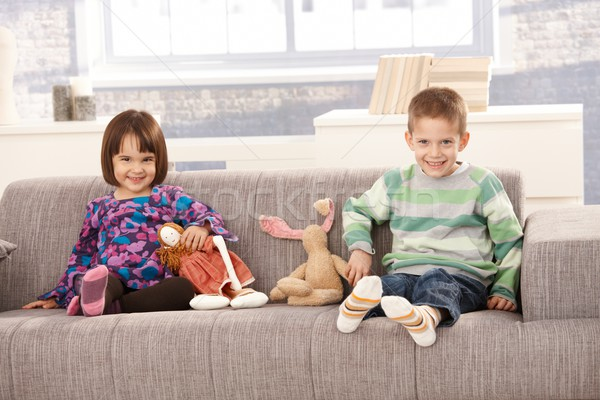 Happy kids sitting on sofa Stock photo © nyul