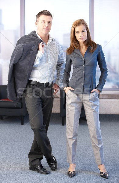 Young businesspeople standing in hall Stock photo © nyul