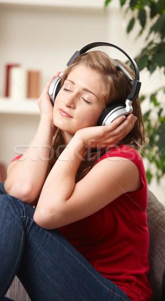 Menina adolescente ouvir música casa fones de ouvido sorridente Foto stock © nyul