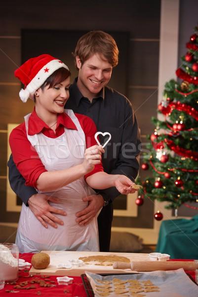 Happy couple baking christmas cake Stock photo © nyul