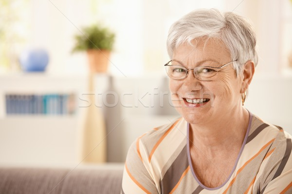 Portrait of happy elderly woman Stock photo © nyul