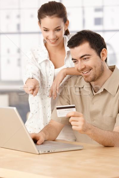 Boldog pár vásárlás online szórakozás mosolyog Stock fotó © nyul