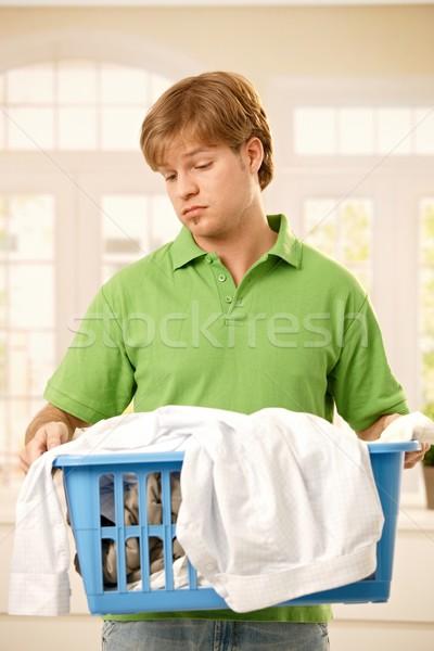 Cara entediado trabalhos domésticos jovem cesta Foto stock © nyul