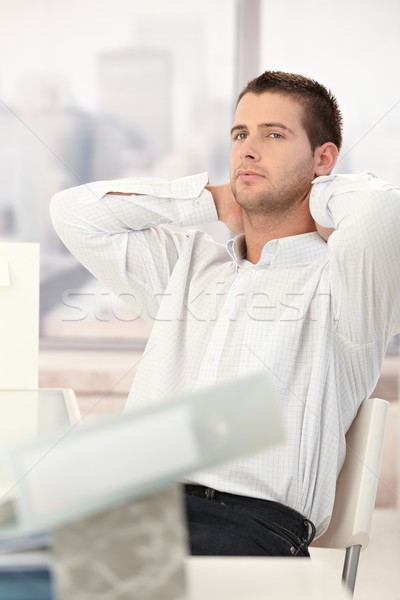 Stock photo: Tired businessman relaxing in chair