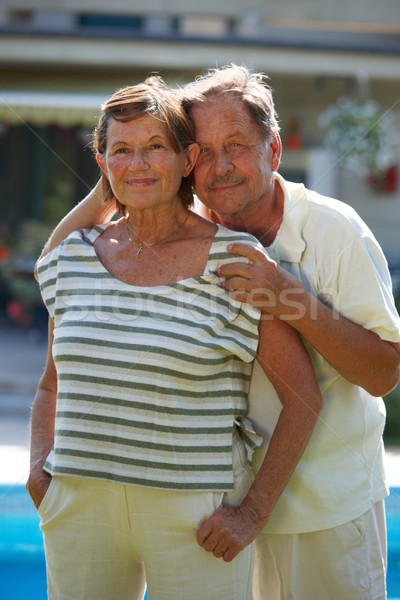Aktív idős pár portré boldog pózol szabadtér Stock fotó © nyul