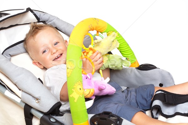 Happy baby in stroller Stock photo © nyul