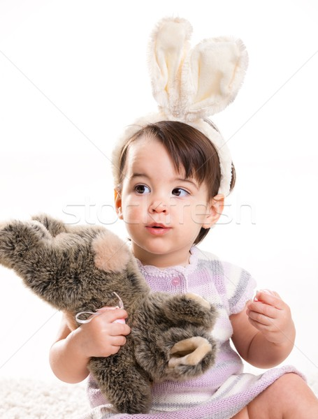 Baby girl playing with toy rabbit Stock photo © nyul