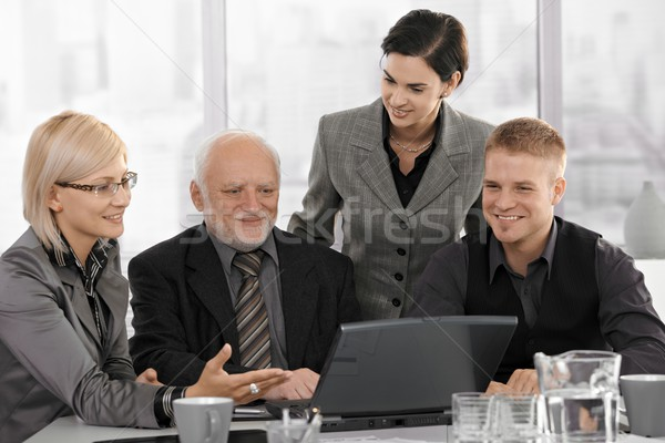 Smiling businessteam on meeting Stock photo © nyul