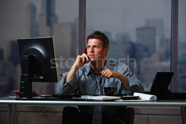 Businessman on call working overtime Stock photo © nyul
