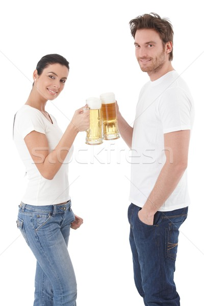 Stock photo: Attractive couple clinking glasses smiling