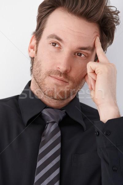 Stock photo: Portrait of thinking businessman