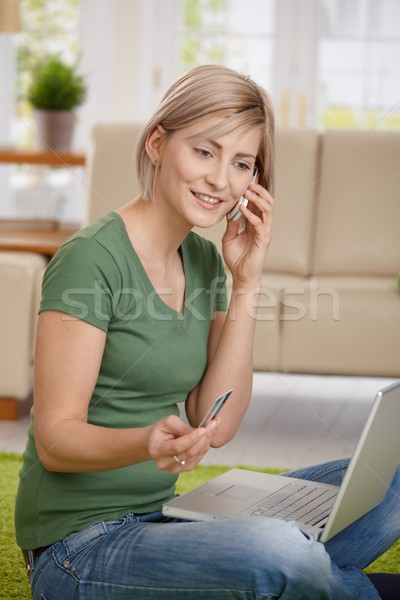 Woman paying bills from home Stock photo © nyul