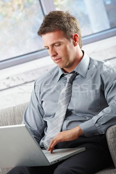 Stock photo: Businessman working on laptop