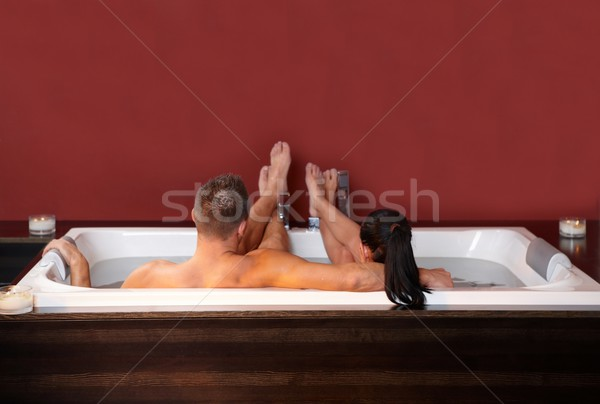 Couple lying in jacuzzi Stock photo © nyul