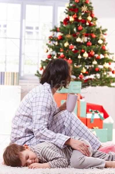 Mother stroking sleeping son at christmas Stock photo © nyul