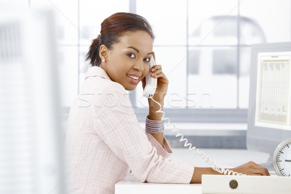 Happy office worker on phone Stock photo © nyul