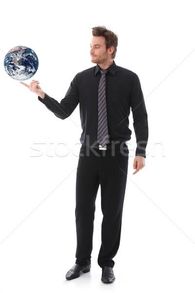 Işadamı dengeleme dünya genç işaret parmağı iş Stok fotoğraf © nyul