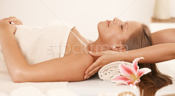 Young woman enjoying neck massage Stock photo © nyul