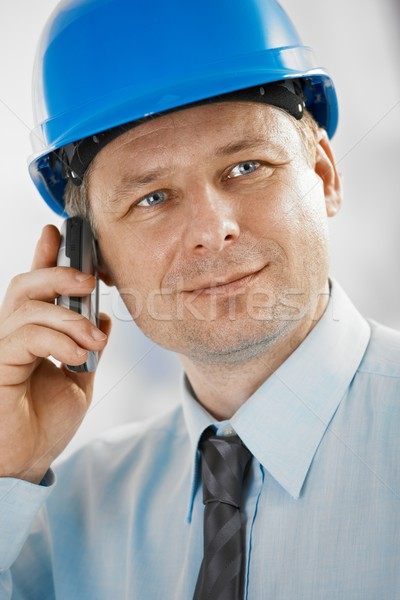 Stock photo: Portrait of architect with mobile