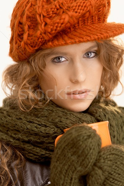 Attractive girl dressed up warm drinking tea Stock photo © nyul